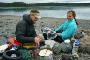 Preparing backcountry pizzas in Glacier Bay National Park, Alaska.